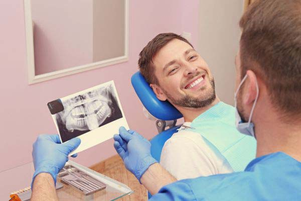 How Dental Implants Can Anchor Dentures